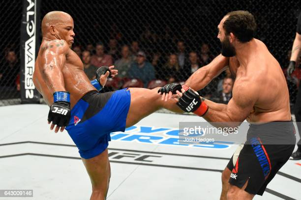 Hector Lombard of Cuba kicks Johny Hendricks in their middleweight fight during the UFC Fight Night event inside the Scotiabank Centre on February 19...