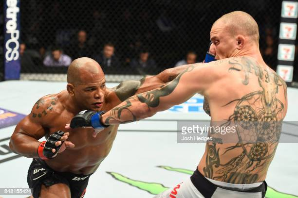 Hector Lombard of Cuba punches Anthony Smith in their middleweight bout during the UFC Fight Night event inside the PPG Paints Arena on September 16...