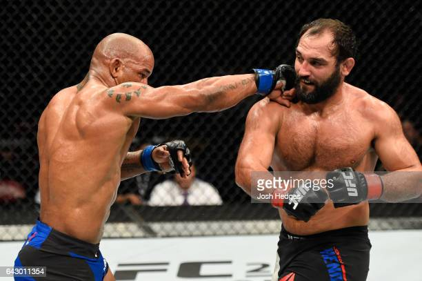 Hector Lombard of Cuba punches Johny Hendricks in their middleweight fight during the UFC Fight Night event inside the Scotiabank Centre on February...