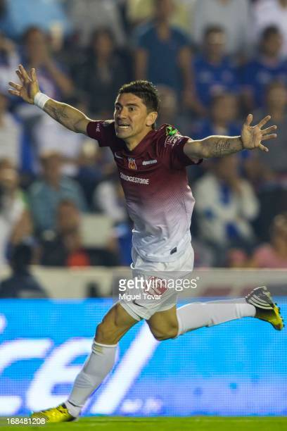 Hector Mancilla of Morelia celebrates after scoring during a match between Cruz Azul and Morelia as part of the Clausura 2013 at Alfonso Lastras...