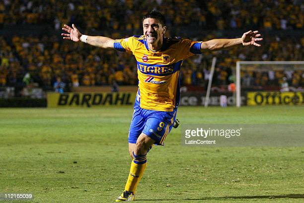 Hector Mancilla of Tigres celebrates a scored goal during a match as part of the Clausura 2011 Tournament in the Mexican Football League at...