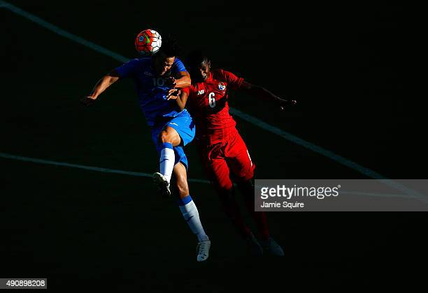 Hector Morales of Cuba battles Fidel Escobar of Panama for a head ball during the 2015 CONCACAF Olympic Qualifying match at Sporting Park on October...