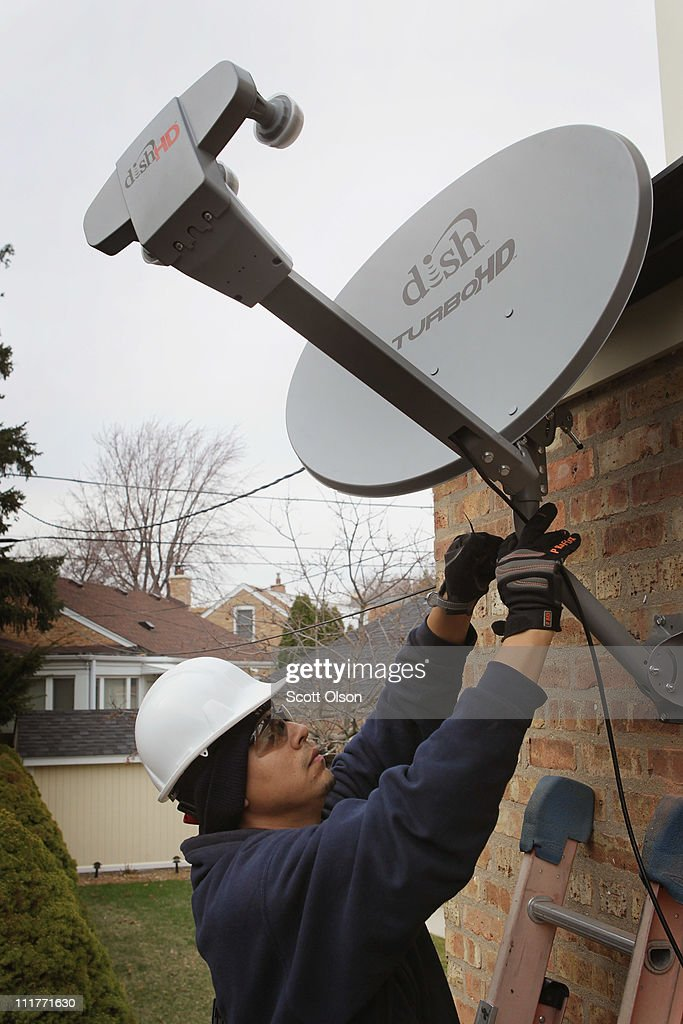 Dish Network Corp Agrees To Buy Blockbuster For $228 Million : News Photo