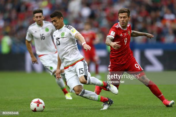 Hector Moreno of Mexico and Fedor Smolov of Russia battle for possession during the FIFA Confederations Cup Russia 2017 Group A match between Mexico...