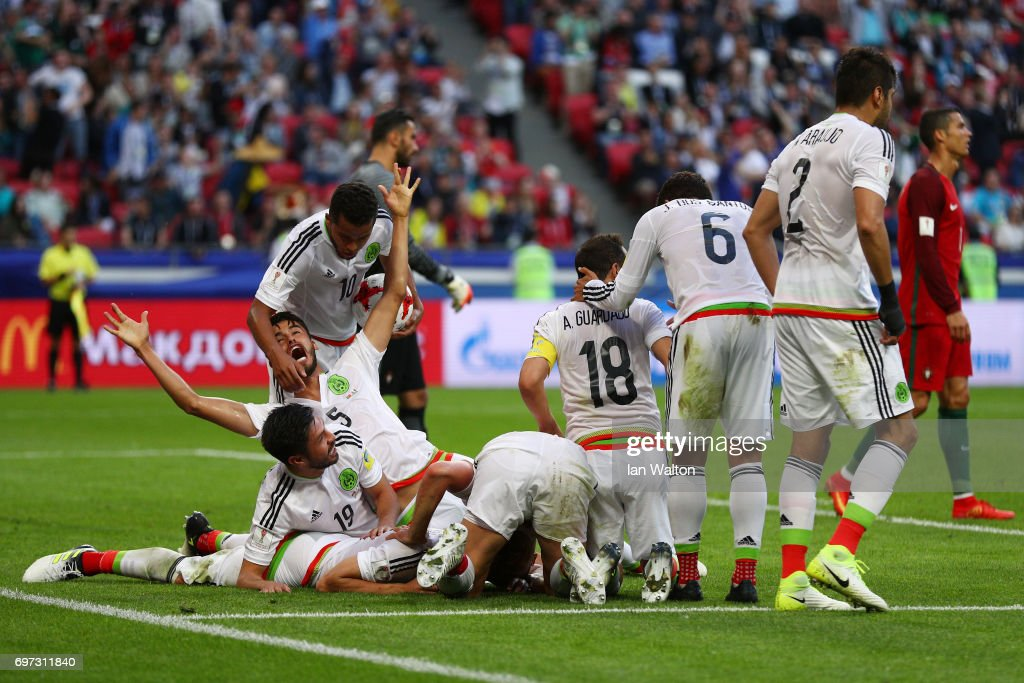 Hector Moreno of Mexico celebrates scoring his sides second goal with his Mexico team mates during the FIFA Confederations Cup Russia 2017 Group A match between Portugal and Mexico at Kazan Arena on June 18, 2017 in Kazan, Russia.