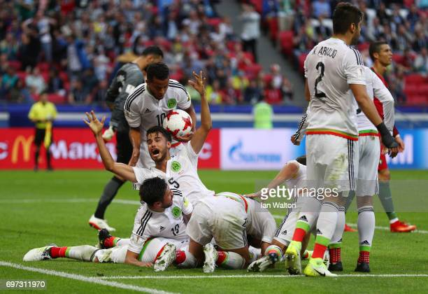 Hector Moreno of Mexico celebrates scoring his sides second goal with his Mexico team mates during the FIFA Confederations Cup Russia 2017 Group A...