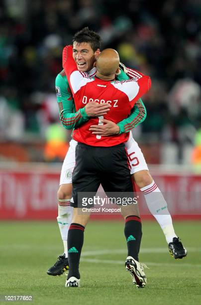 Hector Moreno of Mexico celebrates with Oscar Perez of Mexico after Javier Hernandez opens the scoring during the 2010 FIFA World Cup South Africa...