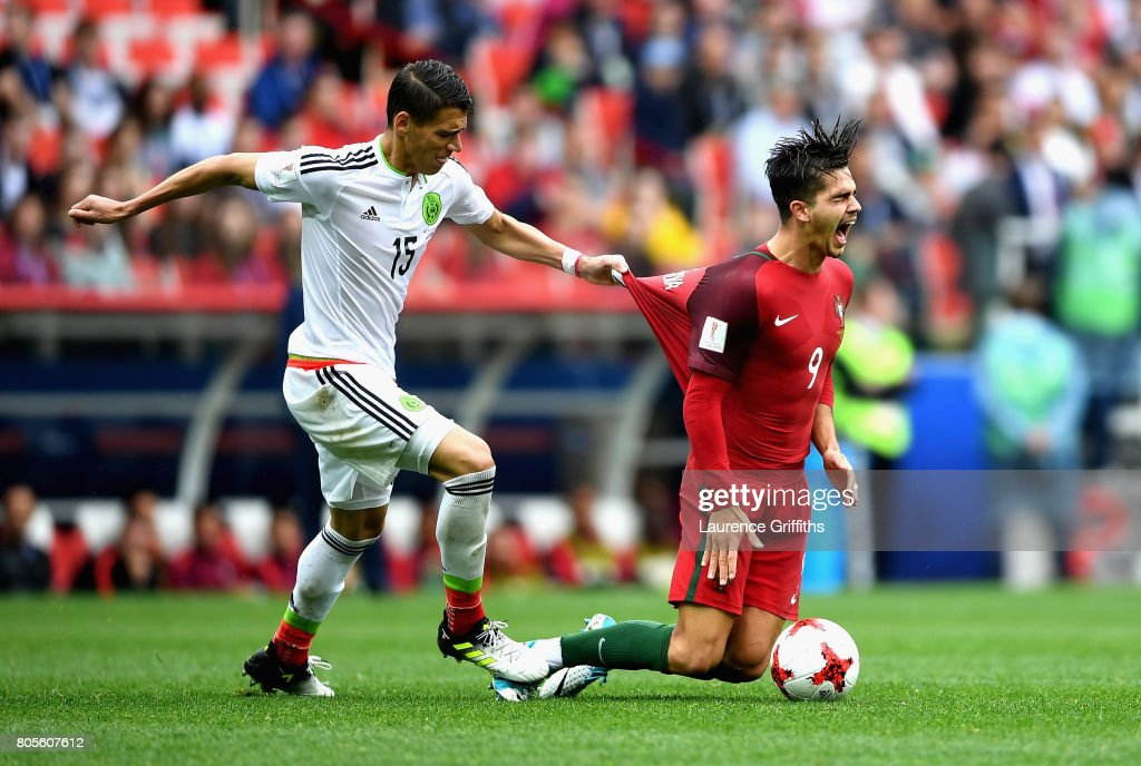 Hector Moreno of Mexico fouls Andre Silva of Portugal during the FIFA Confederations Cup Russia 2017 Play-Off for Third Place between Portugal and Mexico at Spartak Stadium on July 2, 2017 in Moscow, Russia.