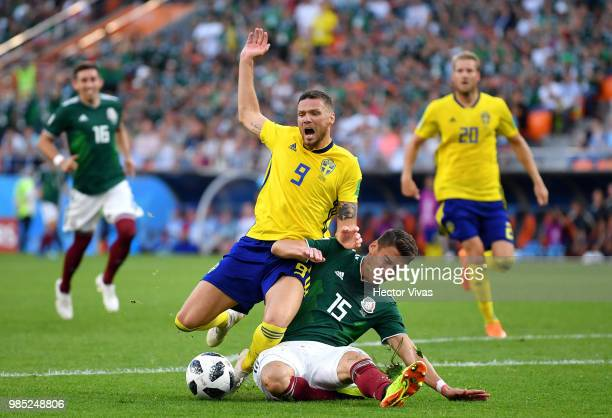 Hector Moreno of Mexico fouls Marcus Berg of Sweden inside the box to concede a penalty during the 2018 FIFA World Cup Russia group F match between...