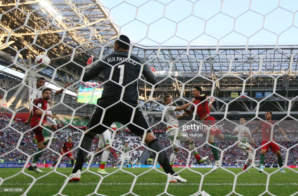 Hector Moreno of Mexico scores his sides first goal past Rui Patricio of Portugal during the FIFA Confederations Cup Russia 2017 Group A match between Portugal and Mexico at Kazan Arena on June 18, 2017 in Kazan, Russia.