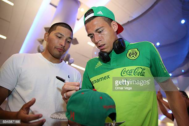 Hector Moreno of Mexico signs the cap of a fan during the Mexico National Team arrival to United States at HartsfieldJackson International Airport on...