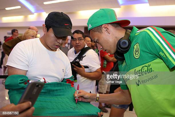 Hector Moreno of Mexico signs the shirt of a fan during the Mexico National Team arrival to United States at HartsfieldJackson International Airport...