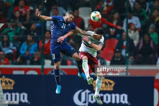 Hector Moreno of Mexico vies for the ball with Nahki Wells of Bermuda during the match between Mexico and Bermuda as part of the Concacaf Nation...