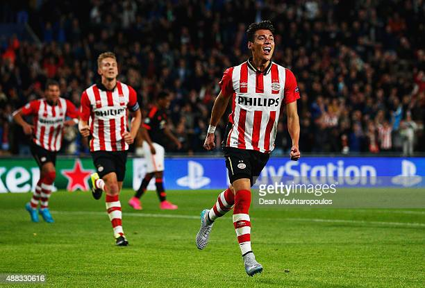 Hector Moreno of PSV Eindhoven celebrates as he scores their first and equalising goal during the UEFA Champions League Group B match between PSV...