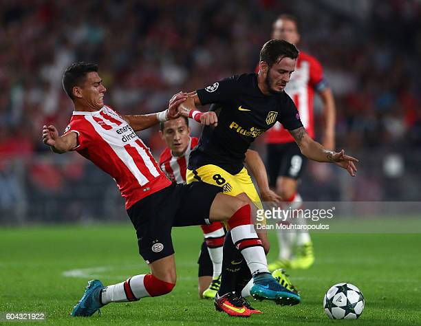Hector Moreno of PSV Eindhoven tackles Saul Niguez of Atletico Madrid during the UEFA Champions League Group D match between PSV Eindhoven and Club...