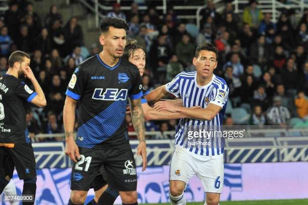 Hector Moreno of Real Sociedad duels for the ball with Hernan Perez of Alaves during the Spanish league football match between Real Sociedad and...