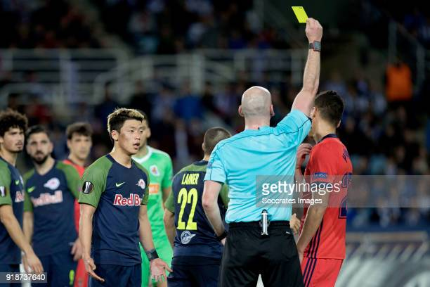 Hector Moreno of Real Sociedad receives a yellow card from referee during the UEFA Europa League match between Real Sociedad v Salzburg at the...