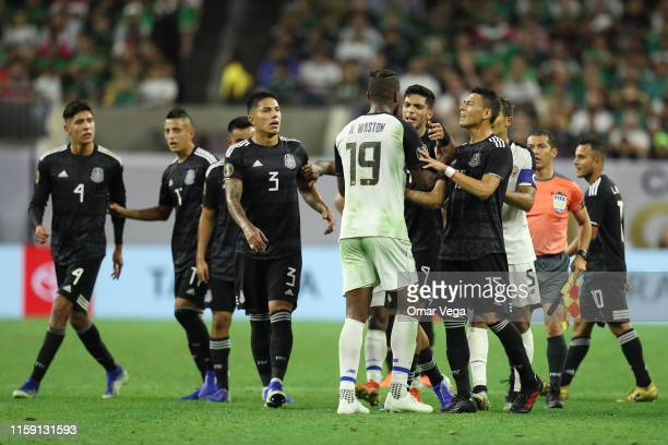 Hector Moreno, Raul Jimenez, Carlos Salcedo of Mexico and Kendall Waston of Costa Rica argue during a quarterfinal match between Mexico and Costa...