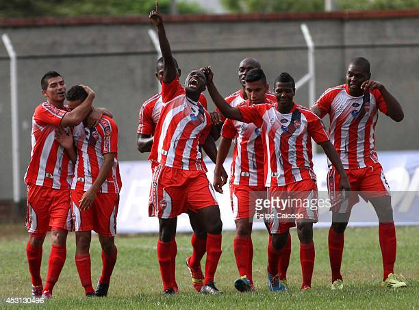 Hector Murillo of Expreso Rojo and his teammates celebrate after scoring the opening goal against America de Cali during a match between America de...