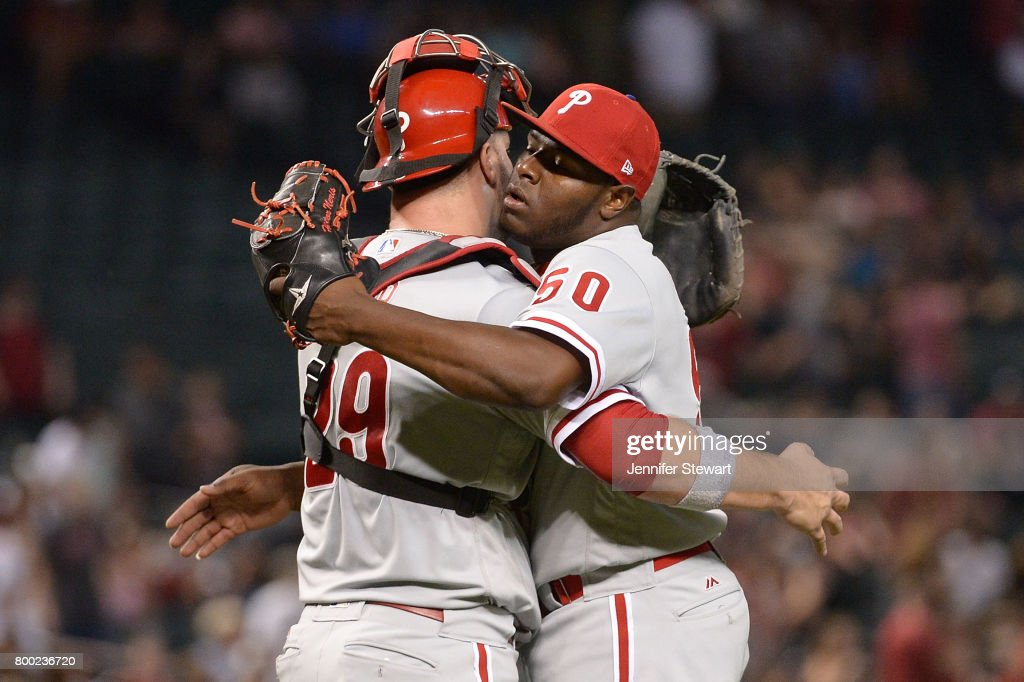 Hector Neris #50 and Cameron Rupp #29 of the Philadelphia Phillies celebrate after closing out the MLB game against the Arizona Diamondbacks at Chase Field on June 23, 2017 in Phoenix, Arizona. The Philadelphia Phillies won 6-1.