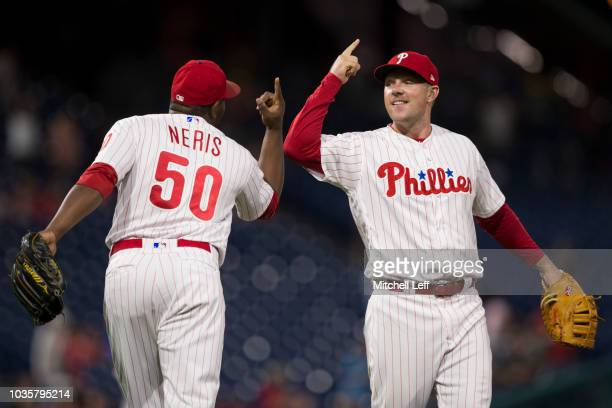 Hector Neris and Rhys Hoskins of the Philadelphia Phillies celebrate their win against the New York Mets at Citizens Bank Park on September 18 2018...