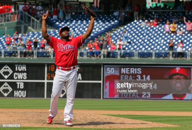 Hector Neris of the Philadelphia Phillies celebrates after saving a game against the Atlanta Braves at Citizens Bank Park on July 31 2017 in...