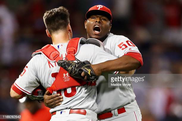 Hector Neris of the Philadelphia Phillies celebrates with Andrew Knapp after the Phillies defeat the Boston Red Sox 32 at Fenway Park on August 20...