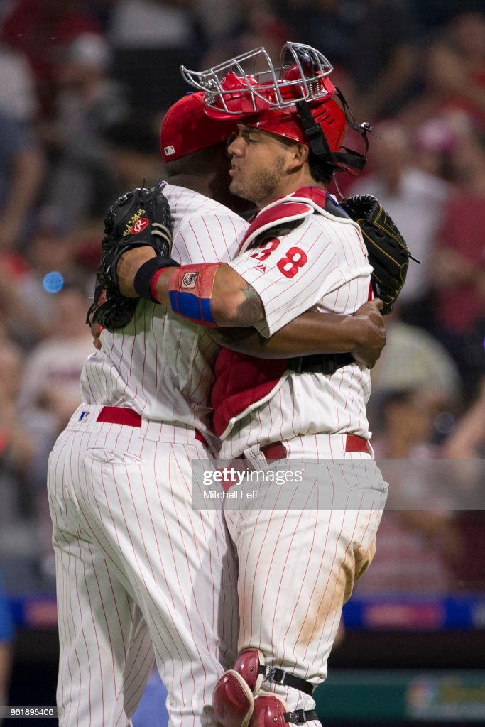 Hector Neris #50 of the Philadelphia Phillies hugs Jorge Alfaro #38 after the game against the Atlanta Braves at Citizens Bank Park on May 23, 2018 in Philadelphia, Pennsylvania. The Phillies defeated the Braves 4-0.