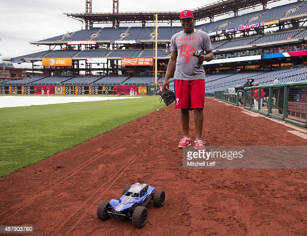 Hector Neris of the Philadelphia Phillies plays with a remote control car prior to the game against the Chicago Cubs on September 12 2015 at Citizens...