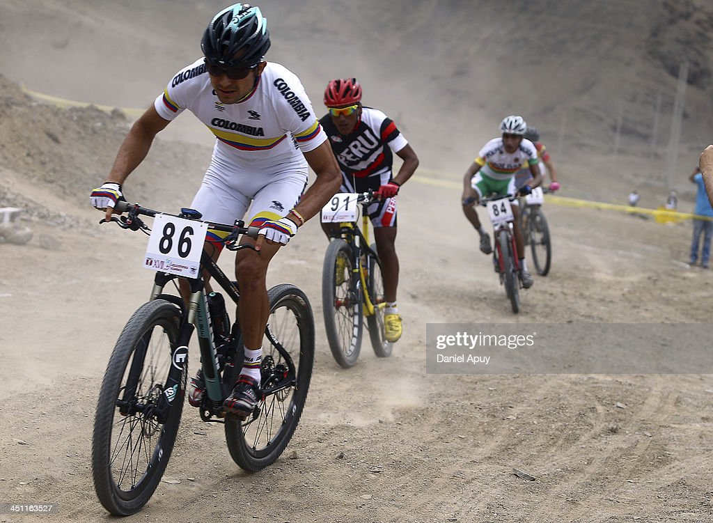 Hector Paez of Colombia and Franco Navarro of Peru compete during the Cross Country Bike Men finals as part of the XVII Bolivarian Games Trujillo 2013 at Morro Solar on November 21, 2013 in Lima, Peru.