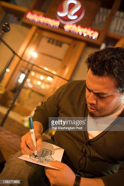 Hector Perla of Silver Spring MD writes a condolence letter at the site of the Lululemon in Bethesda where Jayna Murray was murdered allegedly by her...