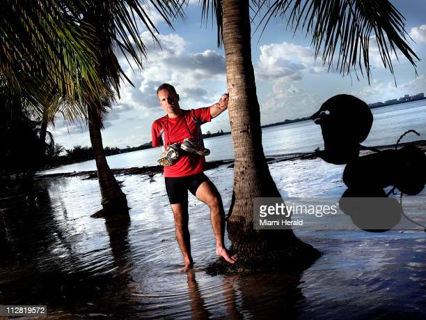 Hector Picard pictured September 17 is an armless triathlete who lost his arms in an electrical accident Picard competed in a triathlon on Key...