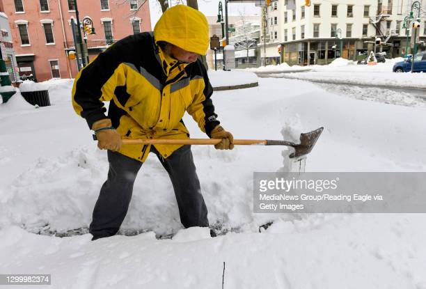 Hector Reyes shovels a path in front of Maria's on Penn street at 4th in Reading. Tuesday morning in Reading, PA February 2, 2021 during a nor'easter...