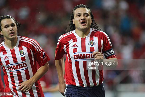 Hector Reynoso of Chivas celebrates a goal during a match between Chivas and Toluca as part of the Torneo Clausura 2012 at Omnilife Stadium on March...