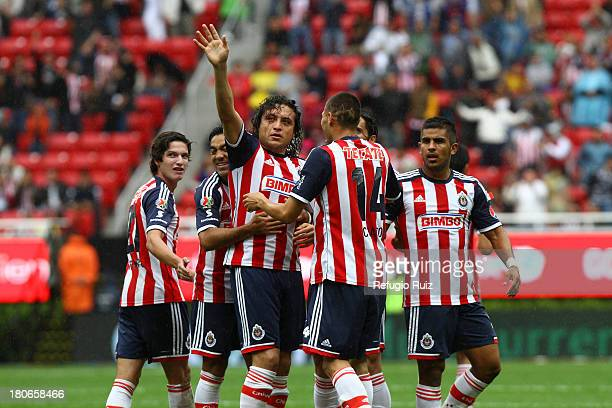 Hector Reynoso of Chivas celebrates his goal during a match between Chivas and Xolos as part of the Torneo Apertura 2013 Liga MX at Omnilife Stadium...