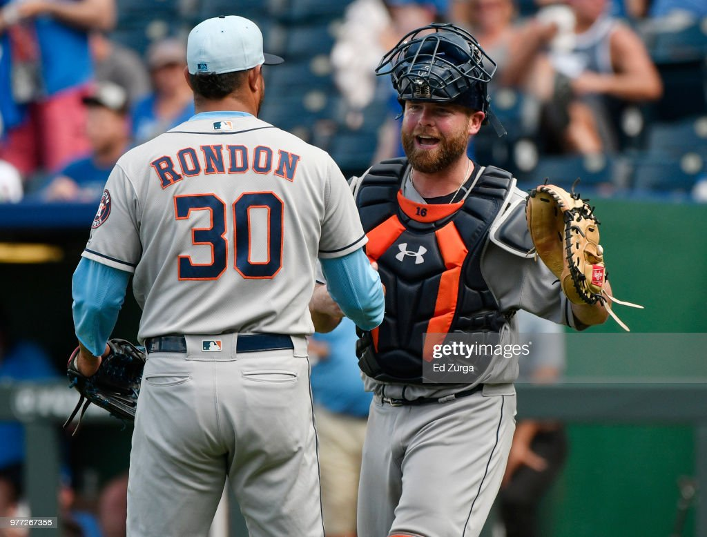 Hector Rondon #30 and Brian McCann #16 of the Houston Astros celebrate a 7-4 win against the Kansas City Royals at Kauffman Stadium on June 17, 2018 in Kansas City, Missouri.