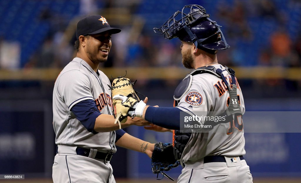 Hector Rondon #30 and Brian McCann #16 of the Houston Astros react to winning a game against the Tampa Bay Rays at Tropicana Field on June 28, 2018 in St Petersburg, Florida.