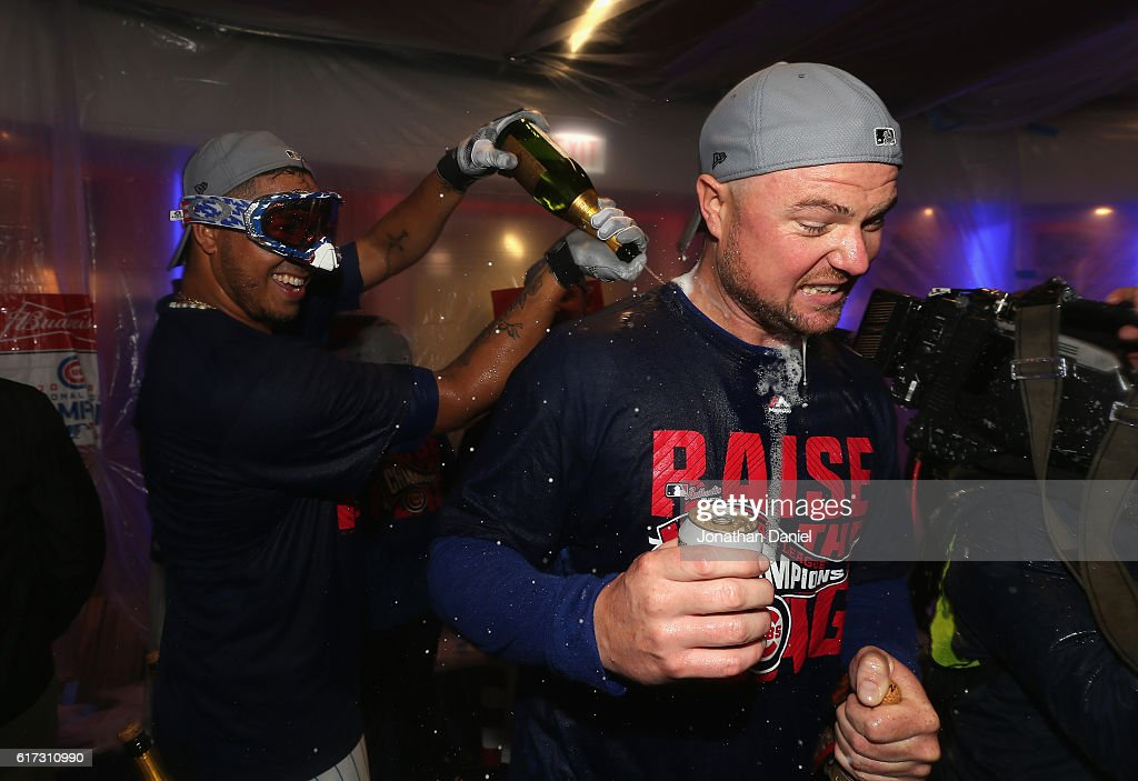 Hector Rondon #56 and Jon Lester #34 of the Chicago Cubs celebrate in the clubhouse after defeating the Los Angeles Dodgers 5-0 in game six of the National League Championship Series to advance to the World Series against the Cleveland Indians at Wrigley Field on October 22, 2016 in Chicago, Illinois.