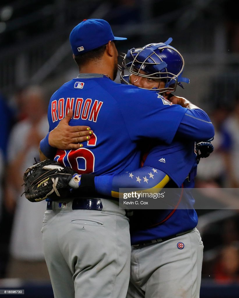 Hector Rondon #56 and Willson Contreras #40 of the Chicago Cubs celebrate their 5-1 win over the Atlanta Braves at SunTrust Park on July 18, 2017 in Atlanta, Georgia.