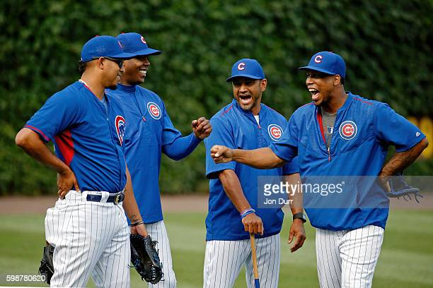 Hector Rondon of the Chicago Cubs Aroldis Chapman bench coach Dave Martinez and Pedro Strop laugh during wamrups before the game against the Chicago...