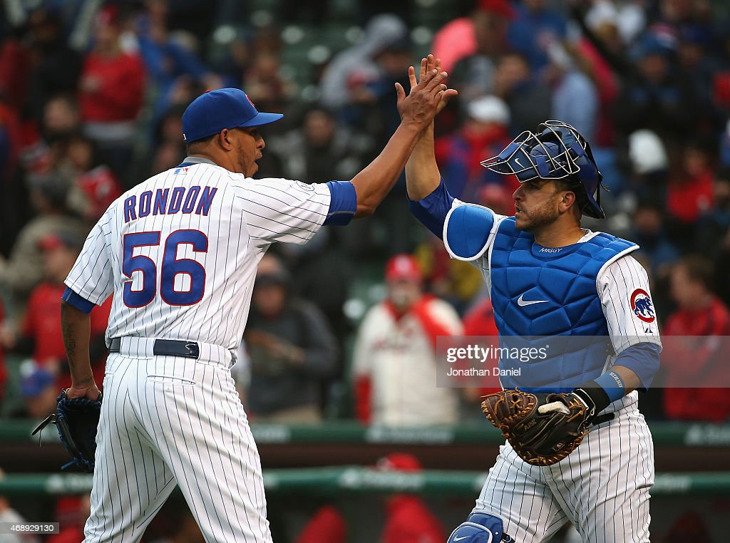 Hector Rondon #56 of the Chicago Cubs celebrates with Miguel Montero #47 after a win against the St. Louis Cardinals at Wrigley Field on April 8, 2015 in Chicago, Illinois. The Cubs defeated the Cardinals 2-0.