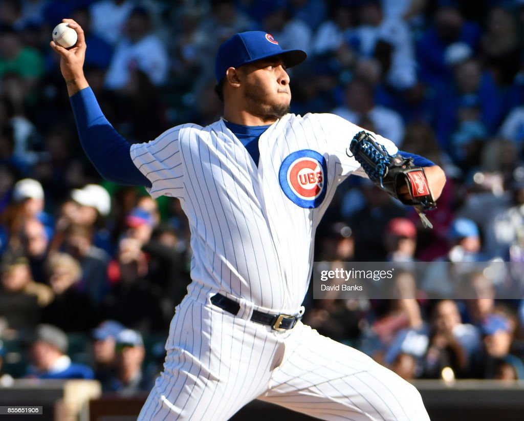 Hector Rondon #56 of the Chicago Cubs pitches against the Cincinnati Reds during the seventh inning on September 29, 2017 at Wrigley Field in Chicago, Illinois.