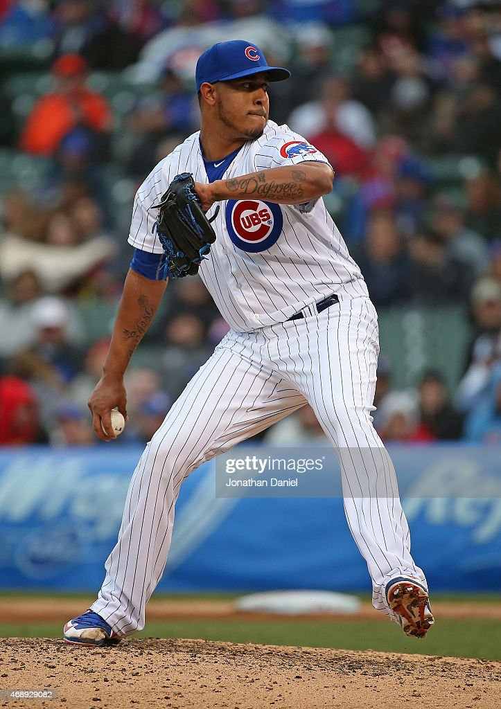 Hector Rondon #56 of the Chicago Cubs pitches in the 9th inning for his first save of the season against the St. Louis Cardinals at Wrigley Field on April 8, 2015 in Chicago, Illinois. The Cubs defeated the Cardinals 2-0.