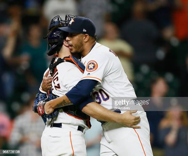 Hector Rondon of the Houston Astros hugs Tim Federowicz after the final out against the Seattle Mariners at Minute Maid Park on June 6 2018 in...
