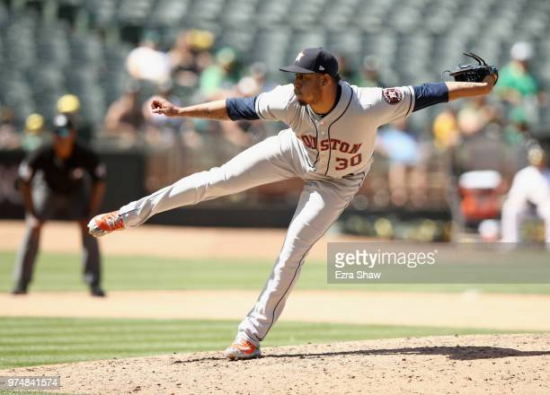 Hector Rondon of the Houston Astros pitches against the Oakland Athletics in the ninth inning at Oakland Alameda Coliseum on June 14 2018 in Oakland...