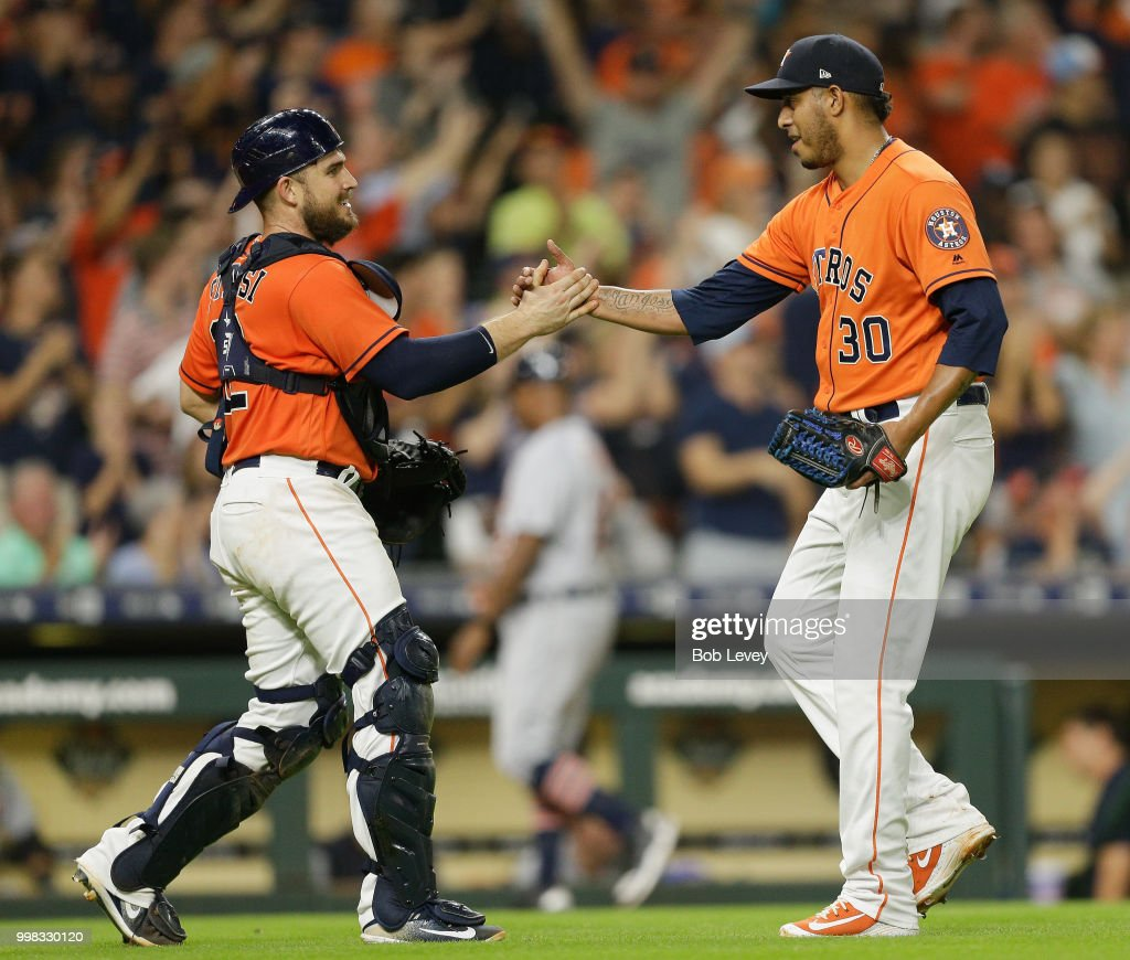 Hector Rondon #30 of the Houston Astros shakes hands with catcher Max Stassi #12 after the final out against the Detroit Tigers at Minute Maid Park on July 13, 2018 in Houston, Texas.
