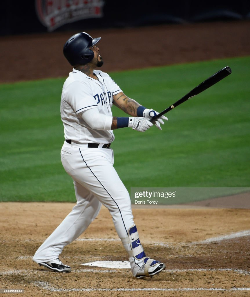 Hector Sanchez #44 of the San Diego Padres hits a two-run home run during the eighth inning of a baseball game against the Detroit Tigers at PETCO Park on June 24, 2017 in San Diego, California.