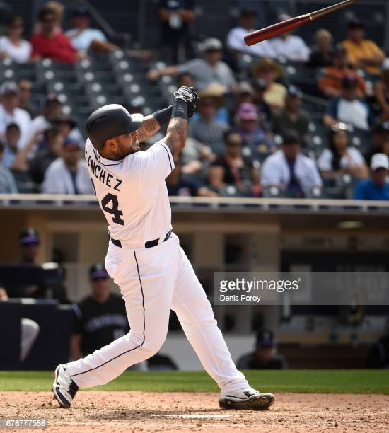 Hector Sanchez of the San Diego Padres loses his bat during the ninth inning of a baseball game against the Colorado Rockies at PETCO Park on May 4...