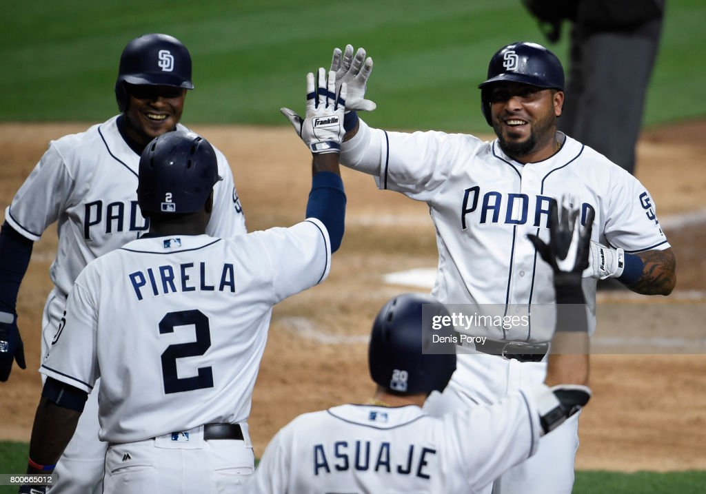 Hector Sanchez #44 of the San Diego Padres, right, is congratulated by Jose Pirela #2 after hitting a two-run home run during the eighth inning of a baseball game against the Detroit Tigers at PETCO Park on June 24, 2017 in San Diego, California.