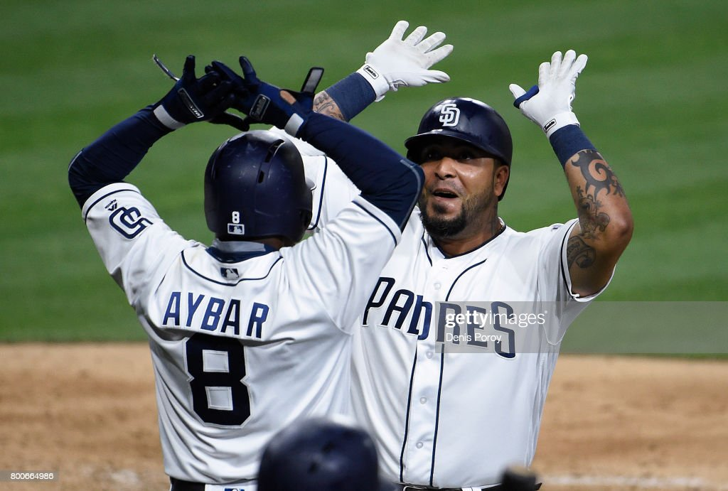 Hector Sanchez #44 of the San Diego Padres, right, is congratulated by Erick Aybar #8 after hitting a two-run home run during the eighth inning of a baseball game against the Detroit Tigers at PETCO Park on June 24, 2017 in San Diego, California.
